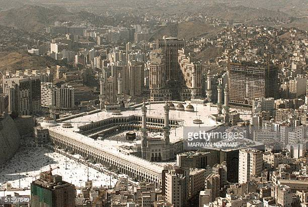 Picture shows an aerial view of the Haram mosque where Muslim pilgrims circled the cubeshaped holy Kaaba for a final seven times in Mecca 18 March...