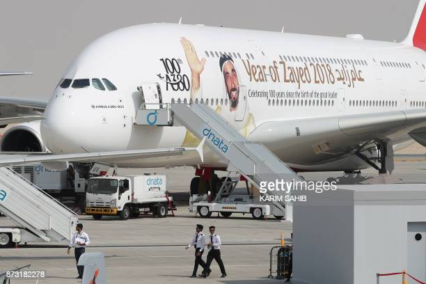 A picture shows an Airbus A380 of Emirates bearing the portrait of late UAE's founder and late president Sheikh Zayed bin Sultan alNahayan during the...