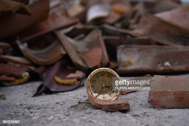 Picture shows an alarm clock stopped at the time of a 6.0 earthquake that hit the city on August 24 killing nearly 300 people, in the historic center...
