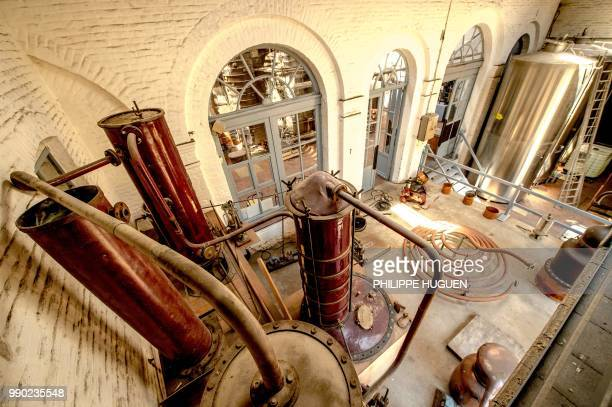 A picture shows an alembic and stockage tanks at the Claeyssens de Wambrechies ditellery on June 28 2018 in Wambrechies Classified as historic...