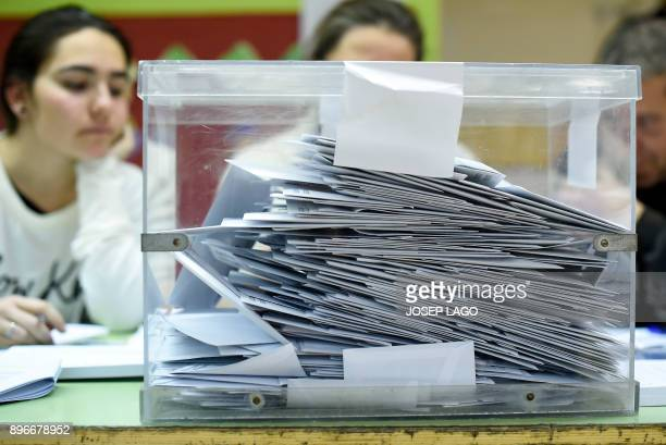 Picture shows an almost full ballotbox for the Catalan regional election at a polling station in Barcelona on December 21 2017 Catalans flooded the...