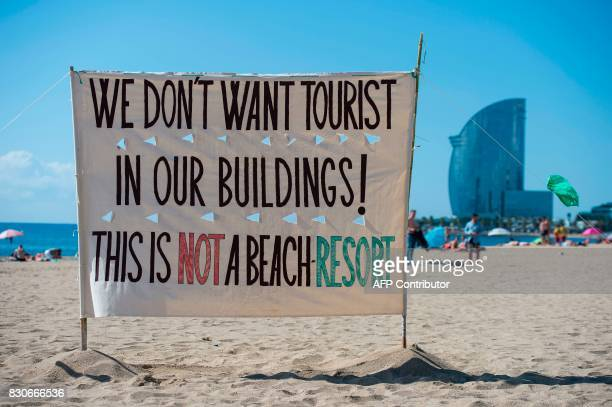 Picture shows an anti tourism banner on La Barceloneta beach during a demonstration against 'drunken tourism' called by the residents of La...