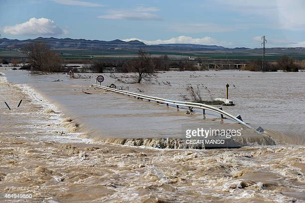 Picture shows an emergency overflow channel opened on a road in the Spanish village of Pina de Ebro to prevent the river from flooding the city of...