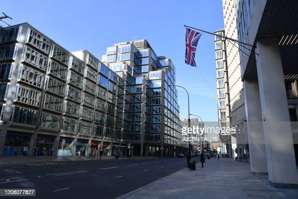 A picture shows an empty street near Victoria Station in central London in the morning on March 24 2020 after Britain ordered a lockdown to slow the...