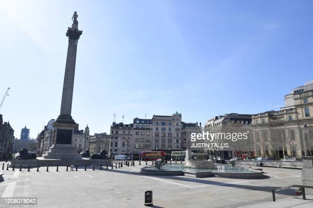 A picture shows an empty Trafalgar Square in central London on March 24 2020 after Britain ordered a lockdown to slow the spread of the novel...