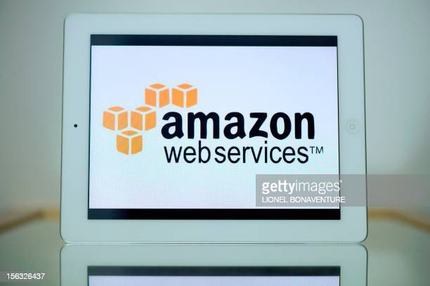 A picture shows an Ipad with the logo of 'Amazon web services' on November 13 2012 in Paris French tax authorities have demanded $252 million in back...