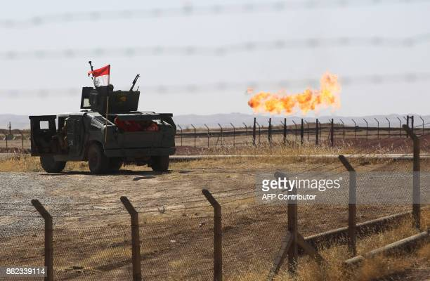 TOPSHOT A picture shows an Iraqi army vehicle at the country's Bai Hassan oil field west of Kirkuk on October 17 2017 Iraqi forces took control of...