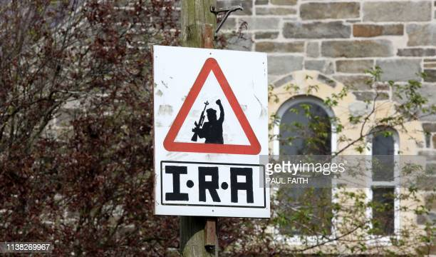 A picture shows an Irish Republican Army sniper warning sign overlooking the Bogside area of Derry in Northern Ireland on April 20 2019 Two teenagers...