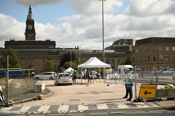 Picture shows an NHS COVID-19 drive-in testing centre in Bolton, northern England on September 9 as local lockdown restrictions are put in place due...