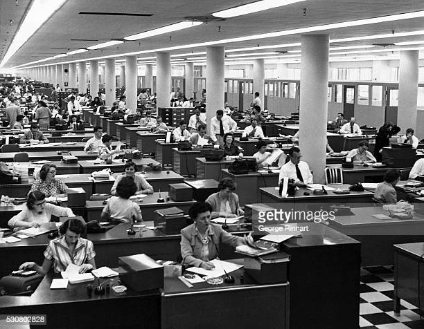 Picture shows an office pool in the late 1950s