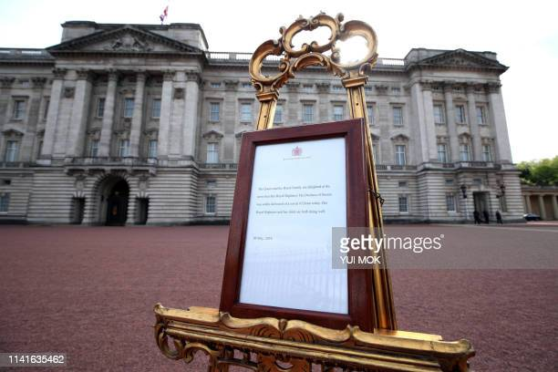 A picture shows an official notice set up on an easel at the gates of Buckingham Palace in London on May 6 2019 announcing the birth of a son to...