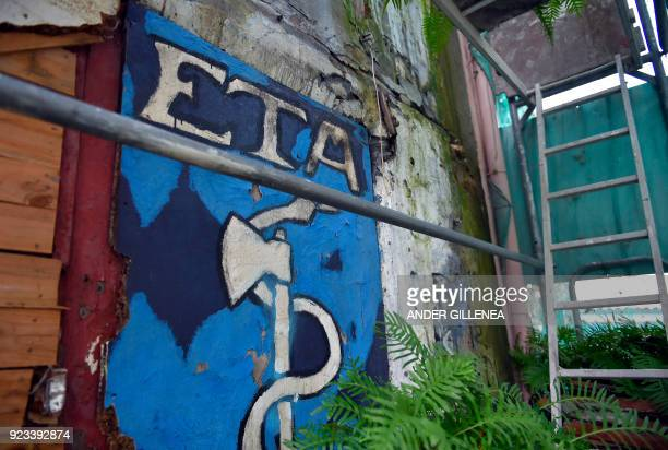 Picture shows an old graffiti depicting the logo of the armed Basque separatist group ETA in the northern Spanish Basque village of Bermeo on...