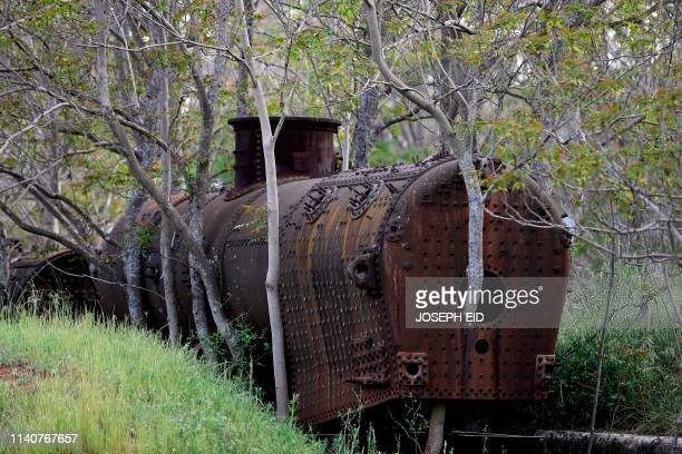 A picture shows an old train locomotive inside the abandoned Riyaq train station in Lebanon's Bekaa Valley on May 01 2019 Rail transport in Lebanon...