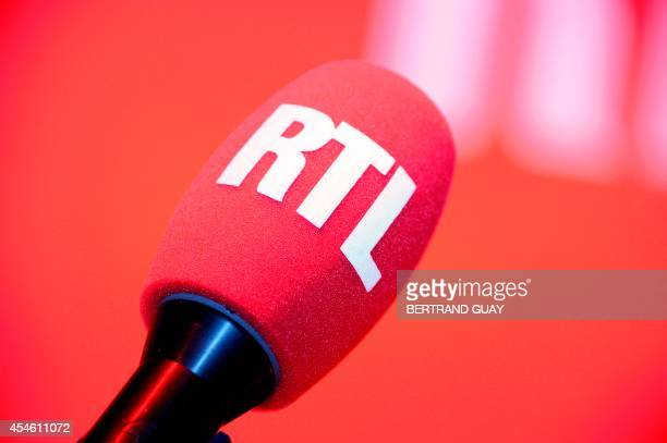 A picture shows an RTL radio microphone during the presentation of the 2014/2015 RTL radio programs on September 4 2014 in Paris AFP PHOTO / BERTRAND...