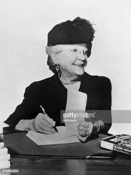 """Picture shows author Laura Ingalls Wilder, of the """"Little House"""" books, published by Harper & Brothers, autographing a book as she is on in years...."""