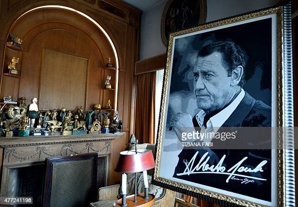 Picture shows awards on the fireplace next to a portrait of late Italian movie star Alberto Sordi inside the villa of the actor during an opening day...