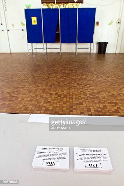 A picture shows ballots in the polling station of Cayenne on the French South American territory of Guiana on January 10 for the referendum on the...