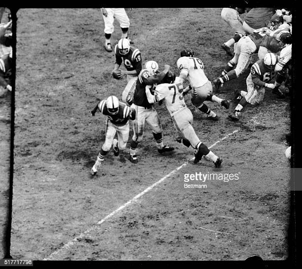 Picture shows Baltimore Colts' Quarterback Johnny Unitas skirting his own Right End for a touchdown from the Giants' threeyard line in the fourth...