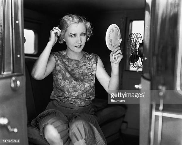 Picture shows Bessie Love American actress converting her car inito a boudoir while on location with MGM's Road Show Company Undated photo circa 1920s