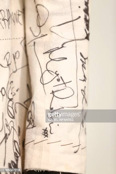 A picture shows British costume designer Sandy Powell's suit full of celebrity signatures including that of Australian actress Margot Robbie before...