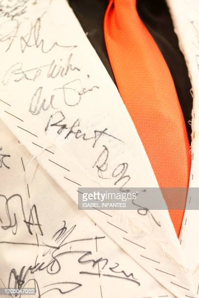 A picture shows British costume designer Sandy Powell's suit full of celebrity signatures including that of US actor Robert De Niro before it goes up...