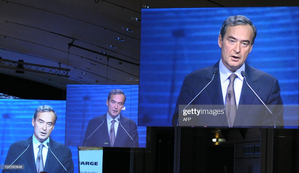 Picture shows Bruno Lafont (on screen), Chief Executive of France's Lafarge, the world's biggest cement maker, addressing the group general meeting in Paris on May 6, 2010. 'the Group maintains its previous estimate that cement volumes in its markets will increase between 0 to 5 percent in 2010 as compared to 2009', Lafarge said on May 5, 2010.