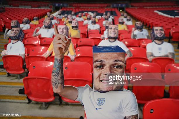 Picture shows cardboard cut-outs of England players on the seats inside Wembley Stadium in London on March 31, 2021 ahead of the FIFA World Cup Qatar...