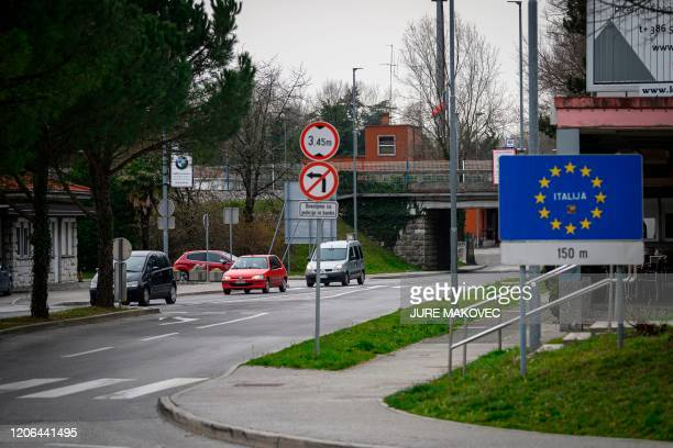A picture shows cars exiting and entering Slovenia at one of the former border crossings in Nova Gorica on the SlovenianItalian border on March 10 as...