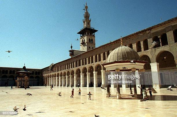 Picture shows children playing in the courtyard of the historic Omayad Mosque in the heart of Damascus' Old City 29 March 2001 Pope John Paul II will...