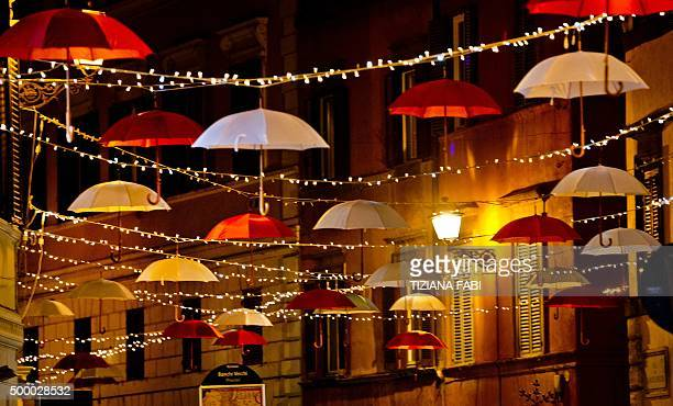 A picture shows Christmas lights and decorations made with white and red umbrellas on December 4 2015 in the Via del Pelligrino in central Rome AFP...