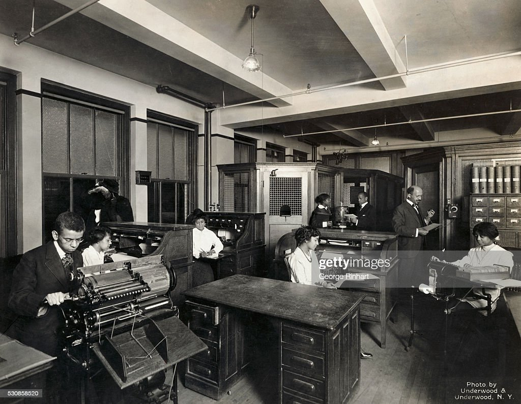 Picture shows civil rights activist, W.E.B. DuBois, in the office (top right) of the NAACP's magazine, Crisis.