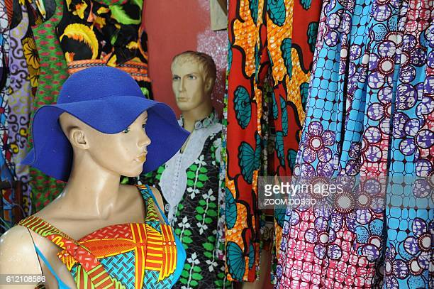 A picture shows clothes displayed in front of an African clothes shop in Monrovia on September 6 2016 After almost 200 years of Western influence on...