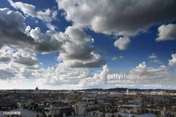 Picture shows clouds over the skyline of Rome on March 4 as seen from the Scuderie del Quirinale.