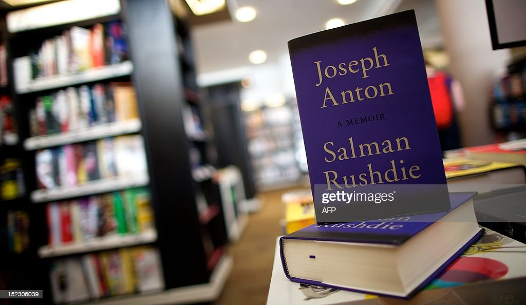 A picture shows copies of the book 'Joseph Anton' a memoir by British author Salman Rushdie in a book shop in central London on September 18, 2012. As violent protests over a US-made film rock the Muslim world, Salman Rushdie publishes his account on September 18 of the decade he spent in hiding while under a fatwa for his book 'The Satanic Verses'. With at least 19 people killed in a week of furious protests over the film, Rushdie's candid memoir of the years spent on the run after he too was accused of mocking Islam, entitled 'Joseph Anton', has an added resonance.