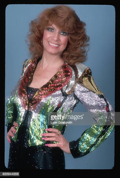 1980 Picture shows country musician star Dottie West wearing a multicolored seqined jacket and satin pants