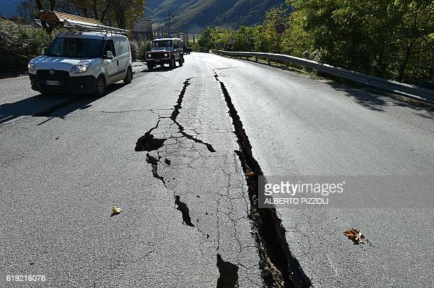 A picture shows cracks on the road outside the center of Norcia after a 66 magnitude earthquake on October 30 2016 It came four days after quakes of...