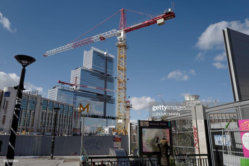 A Picture Shows Cranes And The Porte De Clichy Metro Station Near