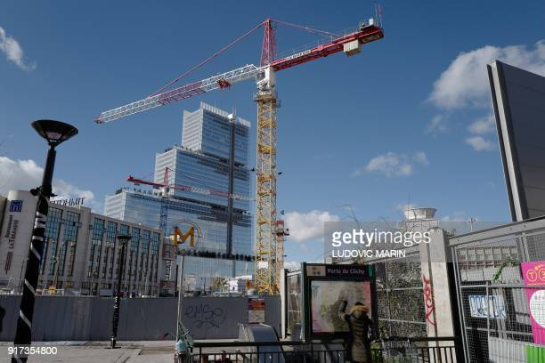A picture shows cranes and the Porte de Clichy metro station near the new 'Palais de Justice' courthouse designed by Italian architect Renzo Piano in...