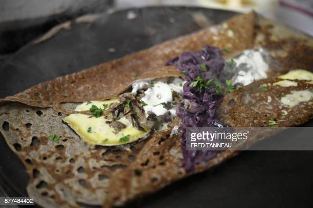 A picture shows crepes made with buckwheat flour in a creperie restaurant in Ploeren western France on November 22 2017 / AFP PHOTO / FRED TANNEAU