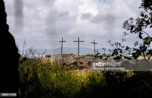 A picture shows crosses erected on a hill near the Cypriot coastal city of Paphos on April 14 during the Good Friday celebrations Christians around...