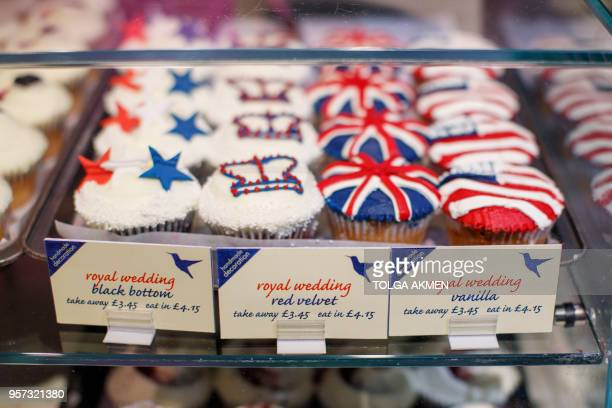 Picture shows cupcakes themed with icing depicting the Union Flag, the US flag, stars and crowns to mark the upcoming Royal Wedding of Prince Harry...