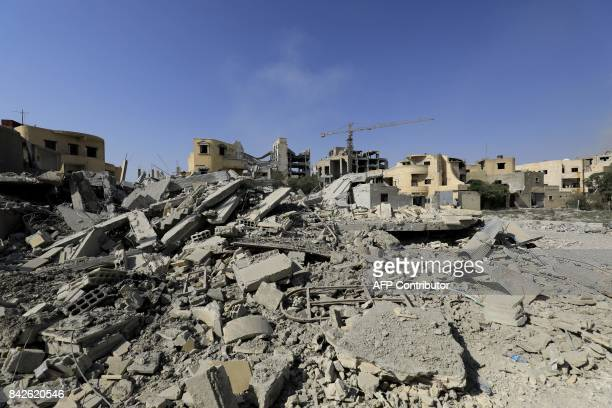 A picture shows damaged buildings in Raqa on September 4 as Syrian Democratic Forces a US backed KurdishArab alliance battle to retake the northern...