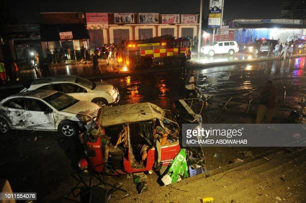 A picture shows damaged vehicles at the site of a car bomb explosion in Mogadishu on August5 2018 At least three were killed and five others injured...