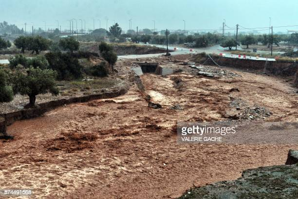 A picture shows damages and floodwaters in the town of Mandra northwest of Athens on November 15 after heavy overnight rainfalls in the area caused...