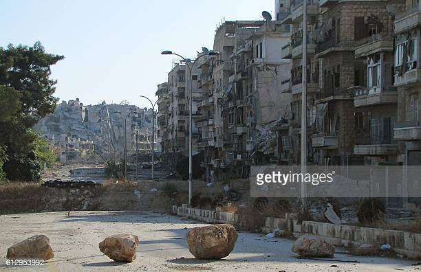 TOPSHOT A picture shows desruction as Syrian progovernment forces advance in Aleppo's Bustan alBasha neighbourhood on October 6 2016 Loyalist...
