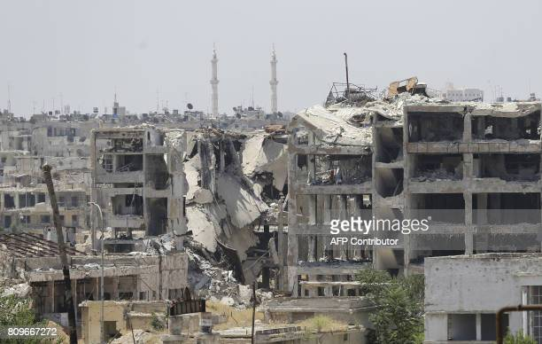 A picture shows destroyed buildings in Aleppo's northwest Layramoun industrial district on July 5 2017 Six months after Syria's army captured the...