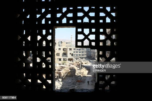 TOPSHOT A picture shows destruction in the town of Harasta in Eastern Ghouta on the outskirts of the Syrian capital Damascus on March 26 2018 Five...