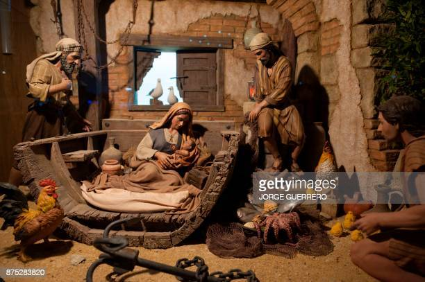 A picture shows details of the Una adoracion de Pastores nativity scene by Rafael Martinez Gomez and Jose Luis Mayo during the inauguration of the...