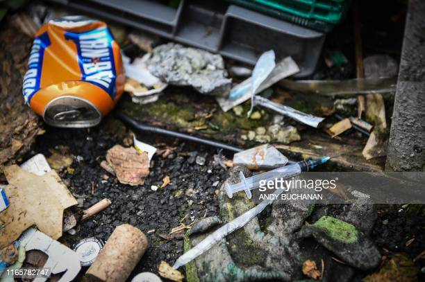 A picture shows discarded drug paraphenallia in a small wooded area used by addicts to take drugs near Glasgow city centre Scotland on August 15 2019...