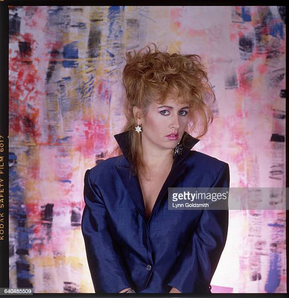 Picture shows disco pop singer Teena Marie posing in a blue satin suit in fron t of a multicolored backdrop Undated photo circa 1980s